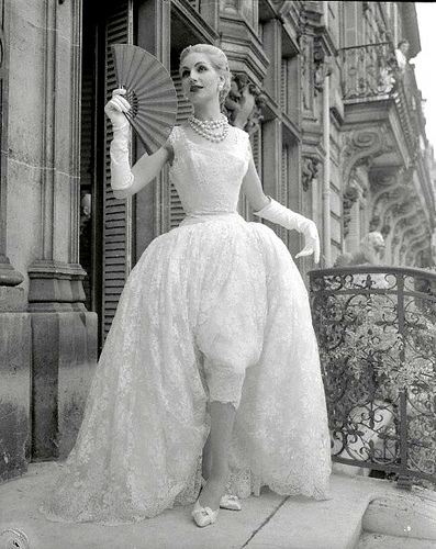 1954 - Givenchy Slim, Short, White-Lace Evening Dress with Billowing Long Overskirt, photo by Stephane Tavoularis, Paris