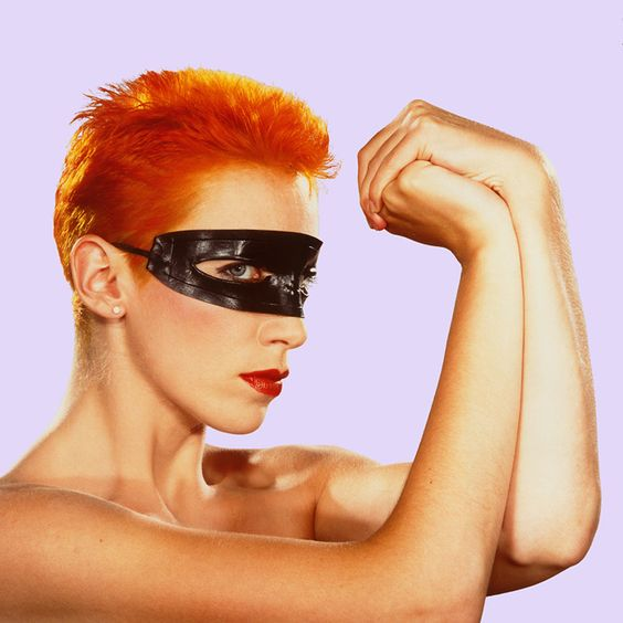 annie lennox from the eurythmics, the Touch sleeve and Face magazine cover